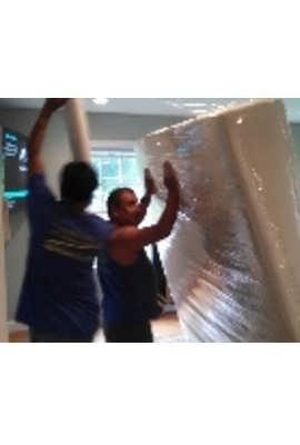 two men packing up mattress