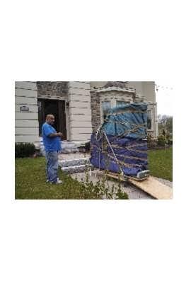 man moving large furniture